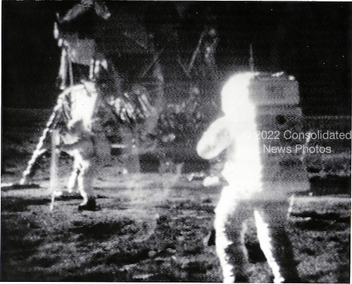 "The Moon - (FILE) -- Astronaut Edwin E. ""Buzz"" Aldrin, Jr., left, deploying the solar wind experiment on the lunar surface during the historic Apollo 11 mission on Sunday, July 20, 1969.  Astronaut Neil A. Armstrong is in the foreground..Credit: NASA via CNP"