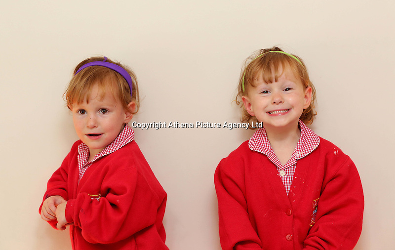 Pictured L-R: Paige with sister Maddison<br /> Re: A set of identical triplets have been colour-coded to help teachers tell them apart on their first day in nursery school.<br /> Three-year-olds Ffion, Maddison and Paige Gilbert, are so alike even their parents struggle to know which is which.<br /> Karen and Ian Gilbert used different coloured nail-varnish on their fingers and toes to identify them when they were babies.<br /> Now the couple are using the same colours for their hair bands and bobbles at the nursery where they have just enrolled.<br /> And the colours even correspond with the names of the identical trio. <br /> Ffion has fuschia, Maddison has mint and Paige has purple.<br /> Karen, 35, of Pontypool, South Wales, said: &quot;We have colour-coded them since they were tiny babies - it helped us keep track of which ones had been fed.<br /> &quot;But nail varnish isn't allowed in school so we had come up with come other way.