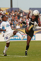 Charmaine Hooper of the Atlanta Beat looses a shoe as she battles Tammy Pearman of the New York Power for the ball during their June 9th game at Mitchel Athletic Complex.  The Beat won 2-0 as Hooper scored her 5th goal of the year on her only shot of the game.