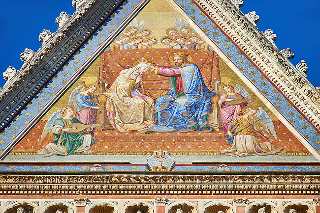 "Close up of the ""Coronation of the Virgin Mary"" osaic  in the topmost gable created between 1350 and 1390 after designs by artist Cesare Nebbia. on the14th century Tuscan Gothic style facade of the Cathedral of Orvieto, Umbria, Italy"