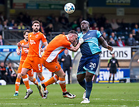 Adebayo Akinfenwa of Wycombe Wanderers and Tom Aldred of Blackpool during the Sky Bet League 2 match between Wycombe Wanderers and Blackpool at Adams Park, High Wycombe, England on the 11th March 2017. Photo by Liam McAvoy.