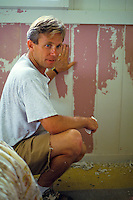 Man remodeling the interior of a house with fresh paint
