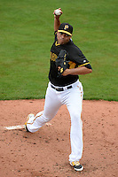 Pitcher Jeanmar Gomez (30) of the Pittsburgh Pirates during a spring training game against the New York Yankees on February 26, 2014 at McKechnie Field in Bradenton, Florida.  Pittsburgh defeated New York 6-5.  (Mike Janes/Four Seam Images)