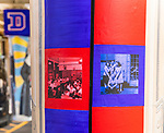 "One of the three new murals installed under the Fullerton ""L"" Station in Lincoln Park, Saturday, July 28, 2018, celebrates the opening of the university's Loop Campus. Other murals installed over the summer include a montage of historical images highlighting the 50th anniversary of DePaul's Black Student Union as well as a caricature of DePaul basketball star George Mikan, a 1959 Naismith Memorial Basketball Hall of Fame inductee.<br /> <br /> Brother Mark Elder, C.M., an adjunct faculty member in DePaul's art, media and design program, conceived of the multi-year art project, titled ""The Story of 'The Little School Under the 'L''. The project will eventually feature 25 murals permanently installed on the massive concrete pillars that support the ""L"" station nearest the university's Lincoln Park Campus. (DePaul University/Jamie Moncrief)"