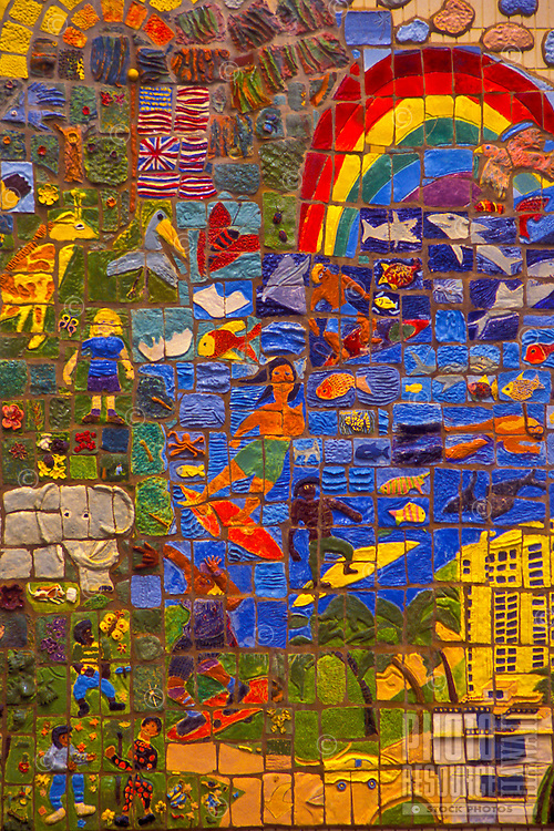 A colorful tile mural depicts fun activities and scenic views in Waikiki.