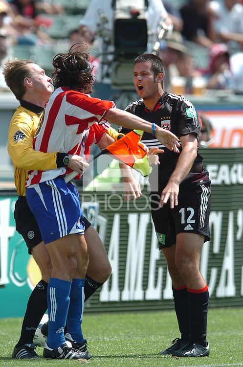 Chivas' Thiago Martin (99) and D.C. United's Mike Petke scuffle over the ball at the Home Depot Center, in Carson, California, Saturday, April 2, 2005.