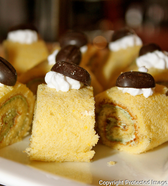 Swiss vanilla rolls with chocolate buttons cream cakes bakery desserts food photo