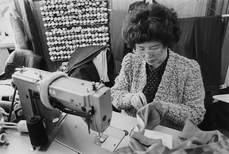 Mrs. S. Park doing alterations at Hill Cleaners and Alterations, 336 Pennsylvania avenue south east in March 1994. (Photo by Maureen Keating/CQ Roll Call via Getty Images)