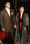 """Ahmad and Phylicia Rashad arrive at the Warner Theatre for the Washington, D.C. Premiere of the movie """"Amistad"""" on December 4, 1997..Credit: Ron Sachs / CNP"""