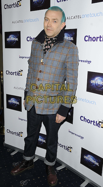 Adamski ( Adam Paul Tinley ).attended the Chortle Comedy Awards 2013, Cafe de Paris, London, England..March 25th, 2013.full length black check jacket  grey gray jeans denim yellow green dyed hair  .CAP/CAN.©Can Nguyen/Capital Pictures.