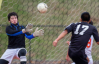 NWA Democrat-Gazette/JASON IVESTER --03/20/2015--<br /> Rogers Heritage senior goalkeeper Derek Groomer (left) fails to make a stop on a shot from Bentonville sophomore Jose Castro (right) during the first half on Friday, March 20, 2015, at David Gates Stadium in Rogers.