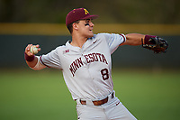 Minnesota Golden Gophers first baseman Micah Coffey (8) throws to first base while warming up in between innings during a game against the Boston College Eagles on February 23, 2018 at North Charlotte Regional Park in Port Charlotte, Florida.  Minnesota defeated Boston College 14-1.  (Mike Janes/Four Seam Images)