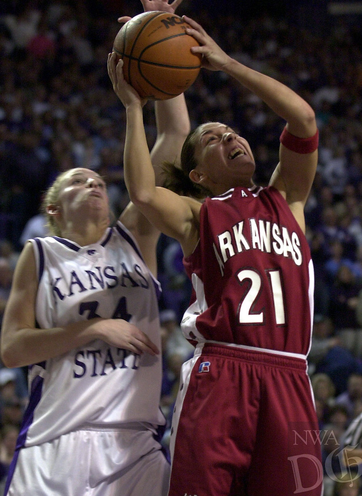 Arkansas Democrat-Gazette/LORI McELROY<br /><br />Arkansas Ladyback India Lewis gets a shot blocked by Kansas State's Megan Mahoney in the last minute of the game.  <br />3-17-02