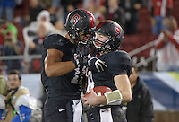 Stanford, Ca - Friday, November 30, 2012: Stanford vs UCLA in the Pac 12 Championships at Stanford University. Kevin Hogan is congratulated after scoring.