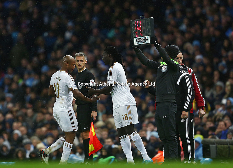 Andre Ayew of Swansea City is replaced by Bafetibis Gomis during the Barclays Premier League match between Manchester City and Swansea City played at the Etihad Stadium, Manchester on December 12th 2015