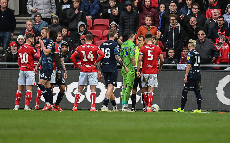 Referee Peter Bankes in a heated discussion with the players from both teams<br /> <br /> Photographer David Horton/CameraSport<br /> <br /> The EFL Sky Bet Championship - Bristol City v Leeds United - Saturday 9th March 2019 - Ashton Gate Stadium - Bristol<br /> <br /> World Copyright © 2019 CameraSport. All rights reserved. 43 Linden Ave. Countesthorpe. Leicester. England. LE8 5PG - Tel: +44 (0) 116 277 4147 - admin@camerasport.com - www.camerasport.com