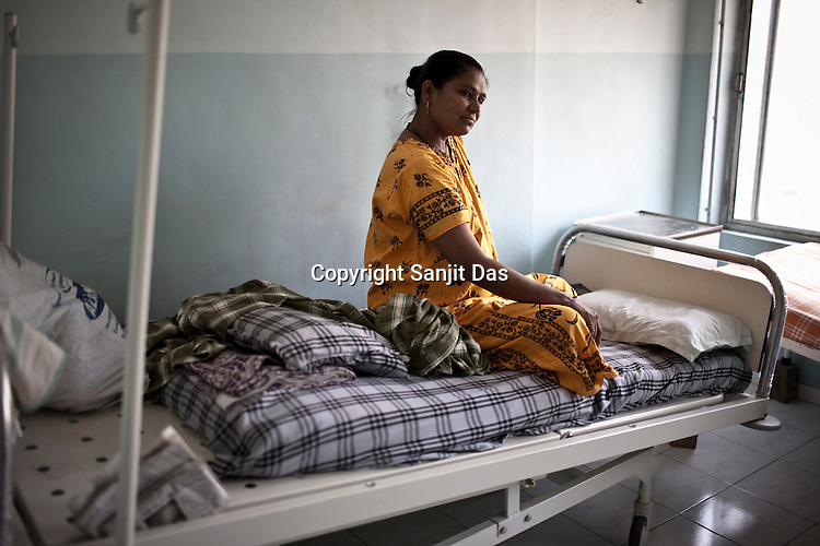 37 year old surrogate mother, Hamza Christian seen at the Akanksha Infertility and IVF Clinic in Anand, Gujarat, India. The centre has become the most popular clinic for outsourcing pregnancies by western couples.