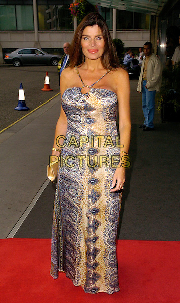 SUSIE BERRICO - BIG BROTHER.Comfort Prima High Street Fashion Awards - Arrivals, London Hilton Park Lane Hotel, London, UK..September 12th, 2006.Ref: CAN.full length blue paisley dress clutch purse .www.capitalpictures.com.sales@capitalpictures.com.©Can Nguyen/Capital Pictures
