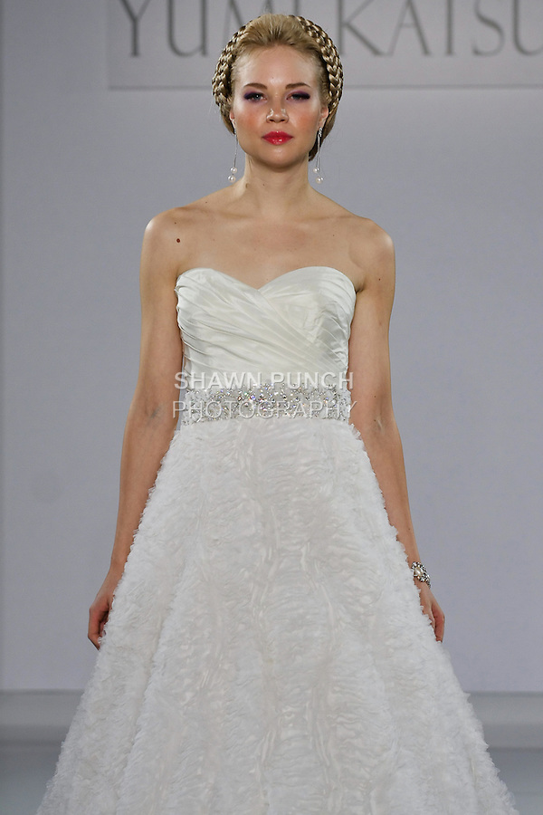 "Model walks runway in an Athens wedding dress from the Yumi Katsura Fall 2013 ""Painting The World With Beauty"" bridal collection, during The Couture Show New York Bridal Fashion Week, October 14, 2012."