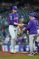 LSU Tigers relief pitcher Nick Storz (21) hands the ball to head coach Paul Mainieri during the game against the Baylor Bears in game five of the 2020 Shriners Hospitals for Children College Classic at Minute Maid Park on February 28, 2020 in Houston, Texas. The Bears defeated the Tigers 6-4. (Brian Westerholt/Four Seam Images)