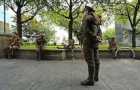 Men in World War I gear in Castle Square Gardens, Swansea, south Wales UK. Friday 01 July 2016