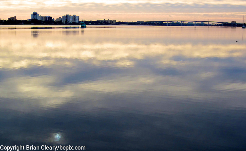 The early morning sky is reflected in the Hailfax River, Holly Hill, Florida.  (Photo by Brian Cleary/www.bcpix.com)