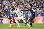 Toni Kroos (l) of Real Madrid fights for the ball with Roberto Rosales of Malaga CF during their La Liga 2016-17 match between Real Madrid and Malaga CF at the Estadio Santiago Bernabéu on 21 January 2017 in Madrid, Spain. Photo by Diego Gonzalez Souto / Power Sport Images