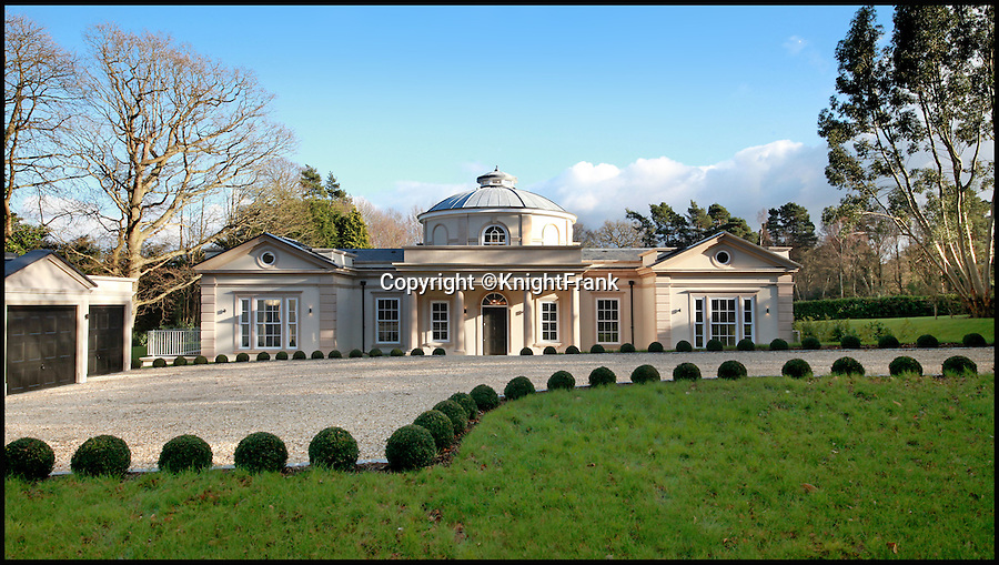BNPS.co.uk (01202 558833)<br /> Pic: KnightFrank/BNPS<br /> <br /> Bolthole-in-one!<br /> <br /> Golf fans will be green with envy - This brand new Palladian style pad comes with a fantastic view of the 17th green at exclusive Wentworth golf club in Surrey.<br /> <br /> But despite the £6.75 million price tag you will still have to pass muster with the members and stump up a £125,000 joining fee to become part of the world famous club.<br /> <br /> Greenside is part of the Wentworth Estate, one of the most expensive private estates in the country, which has the Wentworth Golf Club at its heart.<br /> <br /> The lucky buyer of this house can watch the world's best golfers battle it out for the European Tour's PGA Championship from the balcony overlooking the 17th green of the iconic West Course.<br /> <br /> The newly-built five-bedroom home, on the market with Knight Frank, has everything you could need, including an indoor swimming pool complex with a sauna and a spa.