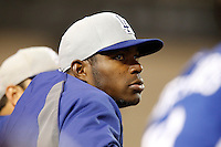Yasiel Puig of the Los Angeles Dodgers watches a game against the Los Angeles Angels in both teams final spring training game at Angel Stadium on March 30, 2013 in Anaheim, California. (Larry Goren/Four Seam Images)