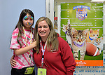 Wantagh, New York, USA. 7th February 2016. SUZANNE FERRARA, with her face painted, and her mother STACY FERRARA, of Plainview, are having fun at Last Hope Animal Rescue's Open House, during Hallmark Channel Kitten Bowl III. The adoption center's volunteers, including Stacy, and visitors watched the game on TV and cheered on their team, the Last Hope Lions. Over 100 adoptable kittens from Last Hope Inc and North Shore Animal League America participated in the taped games, and the Home and Family Felines won the 2016 championship, which first aired the day of Super Bowl 50.