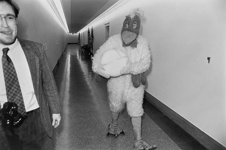 Rep. John Glen Browder, D-Ala., House of Representatives Member, dressed as a chicken with Willaim Killough, executive assistant to the Congressman. November 22, 1991 (Photo by Chris Ayers/CQ Roll Call)