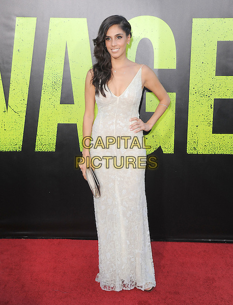 Sandra Echeverria.The World Premiere of 'Savages' held at The Grauman's Chinese Theatre in Hollywood, California, USA..June 25th, 2012.full length dress hand on hip clutch bag white .CAP/RKE/DVS.©DVS/RockinExposures/Capital Pictures.