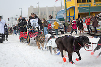 Curt Perano and team leave the ceremonial start line at 4th Avenue and D street in downtown Anchorage during the 2013 Iditarod race. Photo by Jim R. Kohl/IditarodPhotos.com