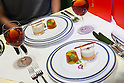 Customers enjoy eating a McDonald's special dinner created by chef Masayo Waki during a ''Restaurant M'' event in the posh Roppongi Hills area on July 27, 2015, Tokyo, Japan. 20 chosen diners (from 8,300 applications) ate a special multi-course dinner created by the celebrity chef using ingredients from the restaurant chain's regular menu. The special one-night only event was organized to celebrate the launch of its new summer menu ''Fresh Mac,'' which features fresh vegetables. The five-course meal served on a white tablecloth with plates and proper cutlery included a Vichyssoise en Pommes de terre de McDonald, Mousse au Poivron Rouge, Salade en Gelee aux Legumes de McDonald, Cinq Pinchos des McDonald Patties avec leur Sauces, a choice of main dish including the Fresh Mac Bacon Lettuce Burger, and a McFlurry Mixed Berry Oreo dessert with a Premium Roast Coffee. (Photo by Rodrigo Reyes Marin/AFLO)