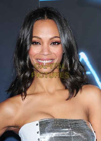 ZOE SALDANA.The Twentieth Century Fox World Premiere of Avatar held at The Grauman's Chinese Theatre in Hollywood, California, USA. .December 16th, 2009.headshot portrait white silver strapless smiling .CAP/RKE/DVS.©DVS/RockinExposures/Capital Pictures.