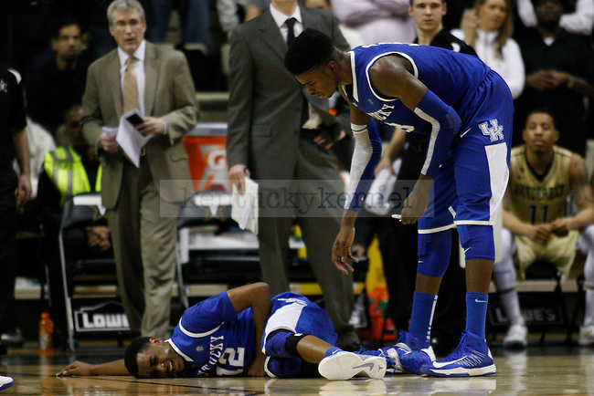 UK forward Nerlens Noel bends over to help guard Ryan Harrow after he was hurt during the second half of the UK vs. Vanderbilt men's basketball game at Memorial Gymnasium in Nashville, Tn., on Thursday, January 10, 2013. UK won 60-58. Photo by Tessa Lighty | Staff