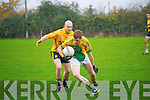 Finuge V Listowel: Finuge's Ian McAulliffer wins the ball despite the close attention of Listowel's Ger McCarthy  in their County Division 2  clash in Finuge on Sunday last.