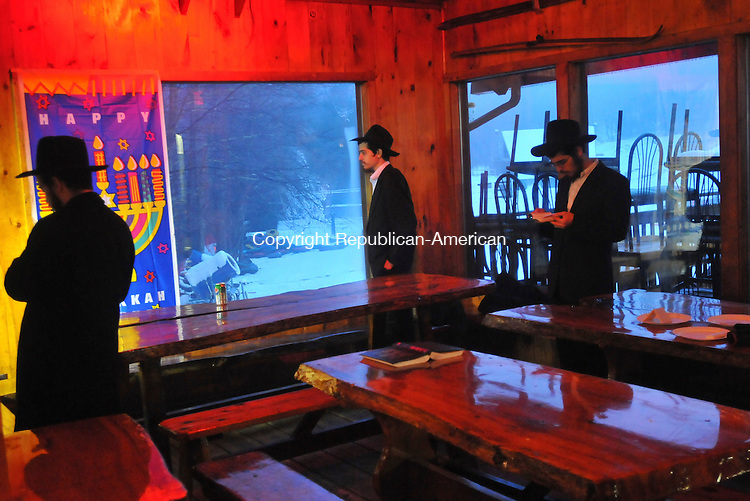 WOODBURY, CT-13 DECEMBER 2009-121309IP04- (l to r) Yosef Gruzman of Austria, and Chain Glitzenstein and Shmuel Glitzenstein, both of Israel, pass time in the cabin at Woodbury Ski Area in Woodbury during what was supposed to be the Chanukah on the Slopes event. Not many people showed up due to the inclement weather.<br /> Irena Pastorello Republican-American