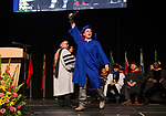 Culinary student Robert Scott Matthew holds up his degree during the TMCC Graduation held at Lawlor Events Center in Reno, Nevada on Friday, May 11, 2018.