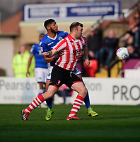 Lincoln City's Matt Rhead vies for possession with Macclesfield Town's Zak Jules<br /> <br /> Photographer Chris Vaughan/CameraSport<br /> <br /> The EFL Sky Bet League Two - Lincoln City v Macclesfield Town - Saturday 30th March 2019 - Sincil Bank - Lincoln<br /> <br /> World Copyright © 2019 CameraSport. All rights reserved. 43 Linden Ave. Countesthorpe. Leicester. England. LE8 5PG - Tel: +44 (0) 116 277 4147 - admin@camerasport.com - www.camerasport.com