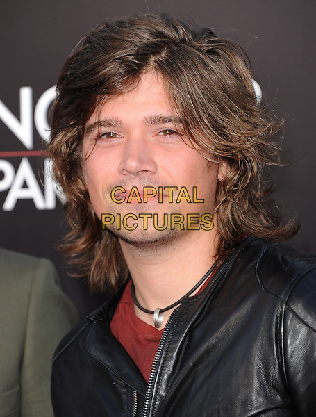 "Zac Hanson of HANSON.""The Hangover Part III"" Los Angeles Premiere held at the Westwood Village Theater, Los Angeles, California, USA..May 20th, 2013.headshot portrait black leather jacket stubble facial hair .CAP/DVS.©DVS/Capital Pictures"