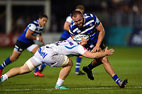 Tom Dunn of Bath Rugby is tackled by Matt Kvesic of Exeter Chiefs. Gallagher Premiership match, between Bath Rugby and Exeter Chiefs on October 5, 2018 at the Recreation Ground in Bath, England. Photo by: Patrick Khachfe / Onside Images