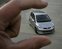 This is a review of the Honda Fit, a tiny little car just released by Honda. Photographed Feb, 16, 2006.