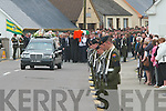 Over 100 army personnel attended the funeral of Private Aidan Holly in Tarbert on Monday. The young man died following a fall from a wall when getting ready to watch the bull run in Pamplona in Spain on July 6th. A 21-gun salute was performed at his graveside.