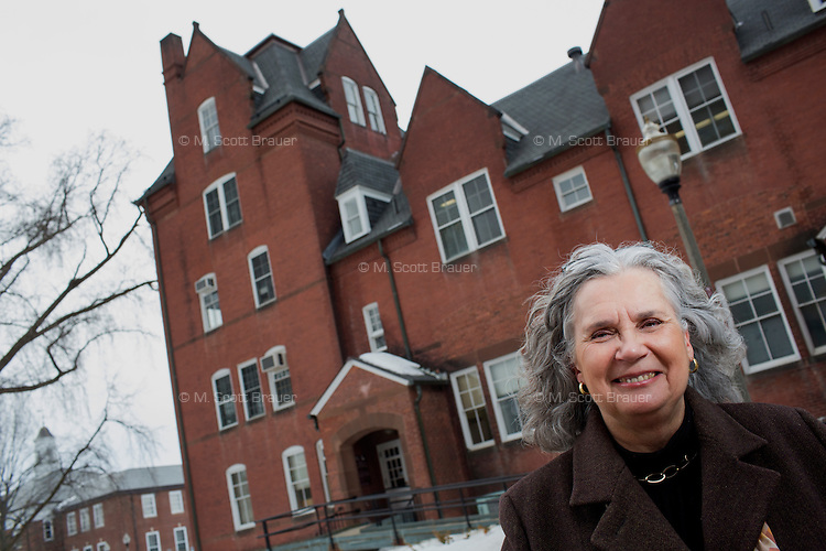 Juanita M. Holler, FAIA, is Associate Vice Chancellor of Facilities & Campus Services at the University of Massachusetts - Amherst in Amherst, Massachusetts, USA. She is standing outside South Campus Hall, a building which currently holds offices but is planned to be repurposed for classroom use after other buildings are demolished as part of the school's restructuring of its layout.