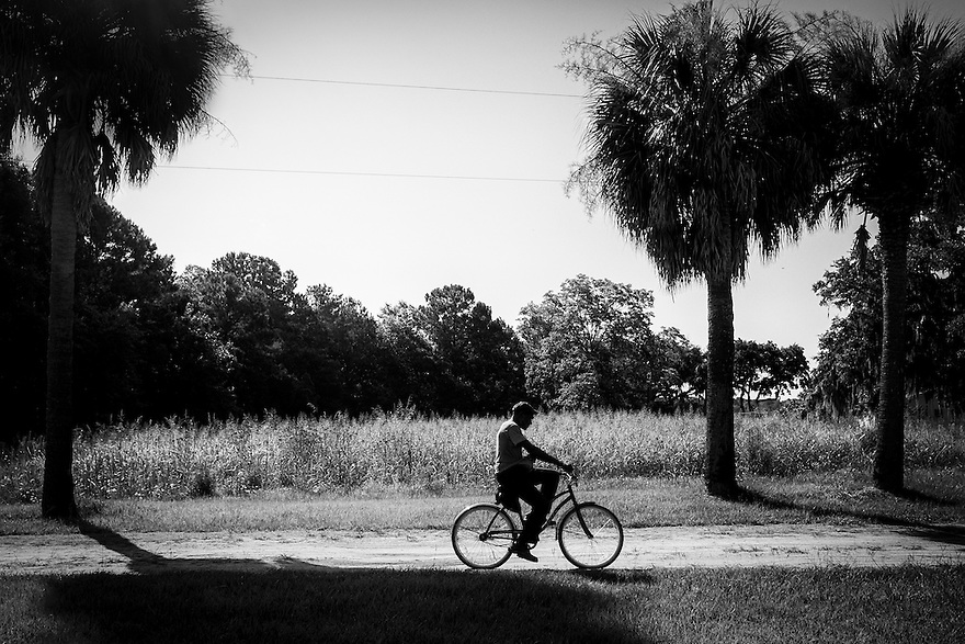 A Gullah man heads home along one of the dirt roads that still connect some of the neighborhoods on St. Helena Island, S.C. <br />