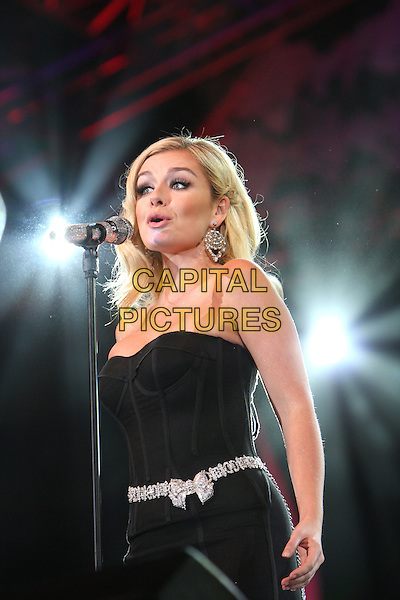 KATHERINE JENKINS .The BBC Proms In The Park at Hyde Park, London, England..September 12th, 2009.stage concert live gig performance music half length black strapless dress microphone singing silver bow belt  .CAP/MAR.© Martin Harris/Capital Pictures.
