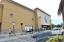 MIRAMAR, FL - April 30: Customers line up outside wearing face masks to enter Sam's Club wholesale store as they struggle to stay open during the Coronavirus (COVID-19) pandemic. As states trying to figure out the right protocol to put in place another to re-open the US economy and the country on April 30, 2020 in Pembroke Pines Florida.   ( Photo by Johnny Louis / jlnphotography.com )