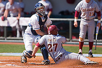 Catcher Jacob Stallings #5 of the North Carolina Tar Heels blocks home plate as Stuart Tapley #27 of the Florida State Seminoles tries to score at Boshamer Stadium March 20, 2010, in Chapel Hill, North Carolina.  Photo by Brian Westerholt / Four Seam Images