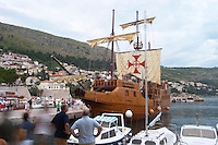 The Karaka 16 century galleon replica boat in the old harbour . Other boats moored. Dubrovnik, old city. Dalmatian Coast, Croatia, Europe.